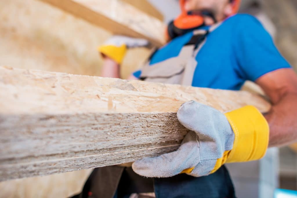 Worker with Wooden Materials in Hands. Closeup Photo.